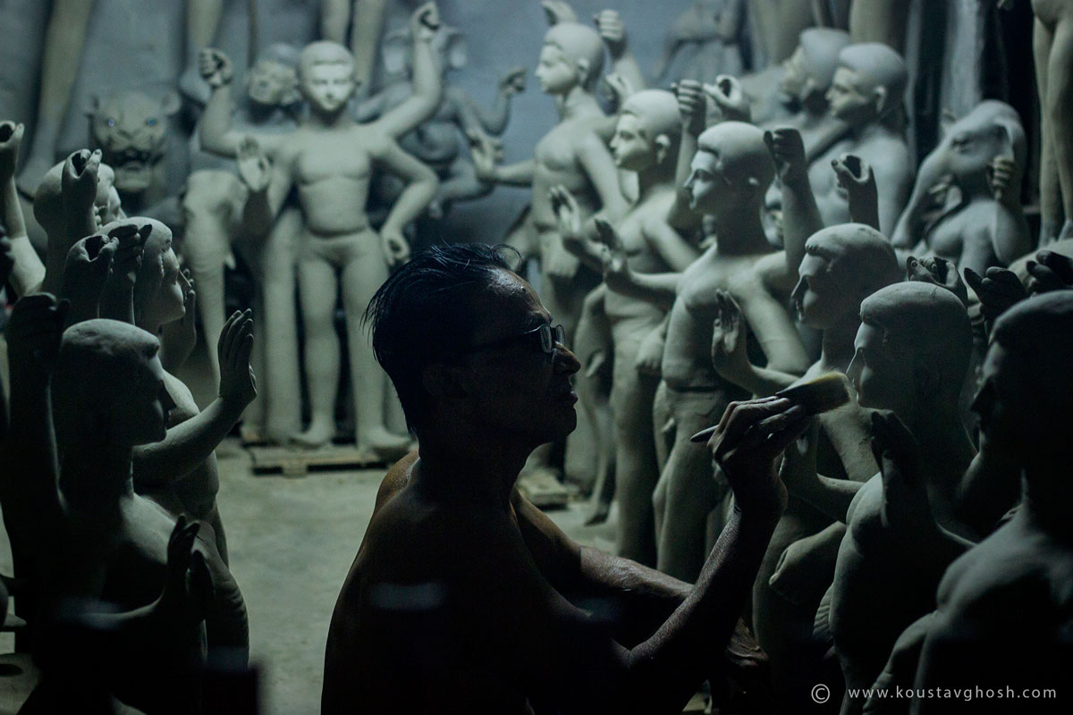 Man making idols Image