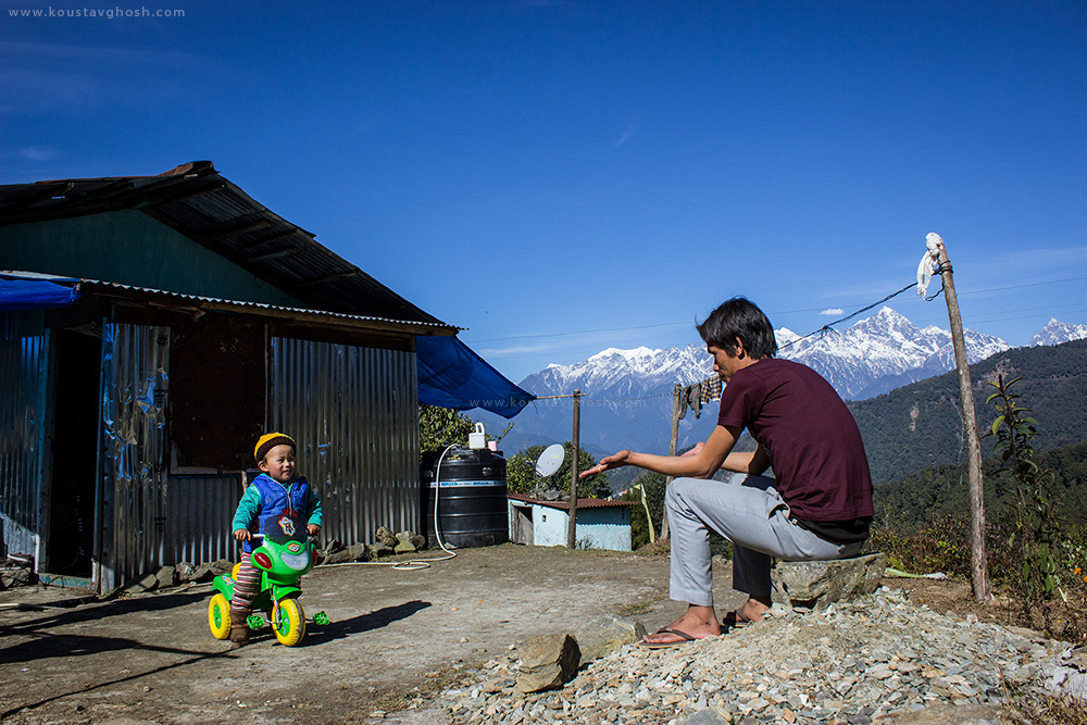 A resident of Tibetan Refugee Settlement Camp with his child