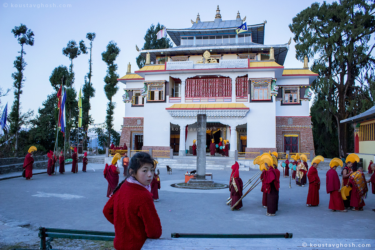 Little monks were getting ready for the event and a little girl was watching in front of new Ralang Monastery