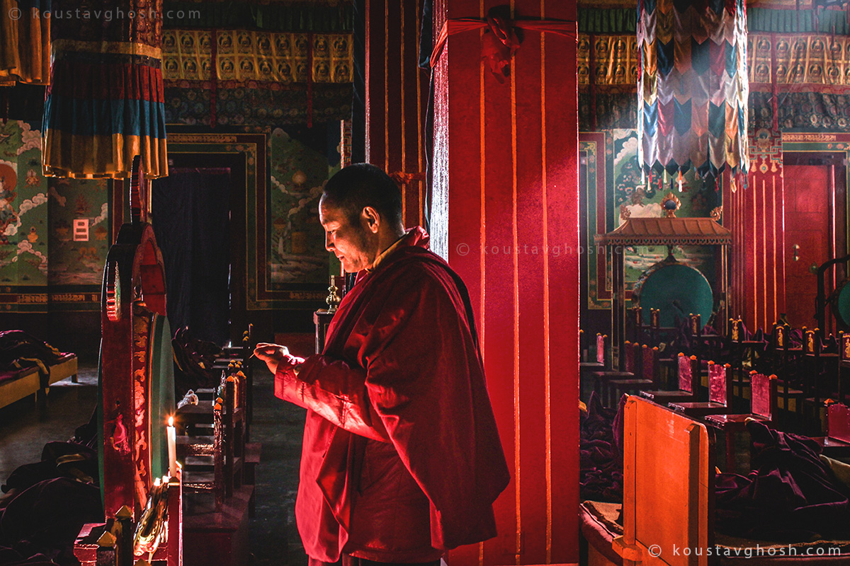 A monk was lighting a candle inside the temple of new Ralang Monastery