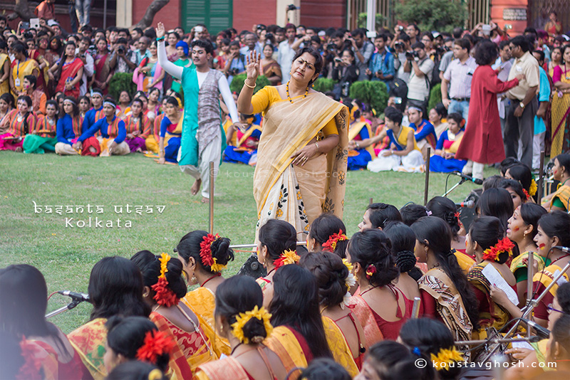 The teacher seen helping students in their performance during Basanta Utsav at Jorasanko Thakurbari