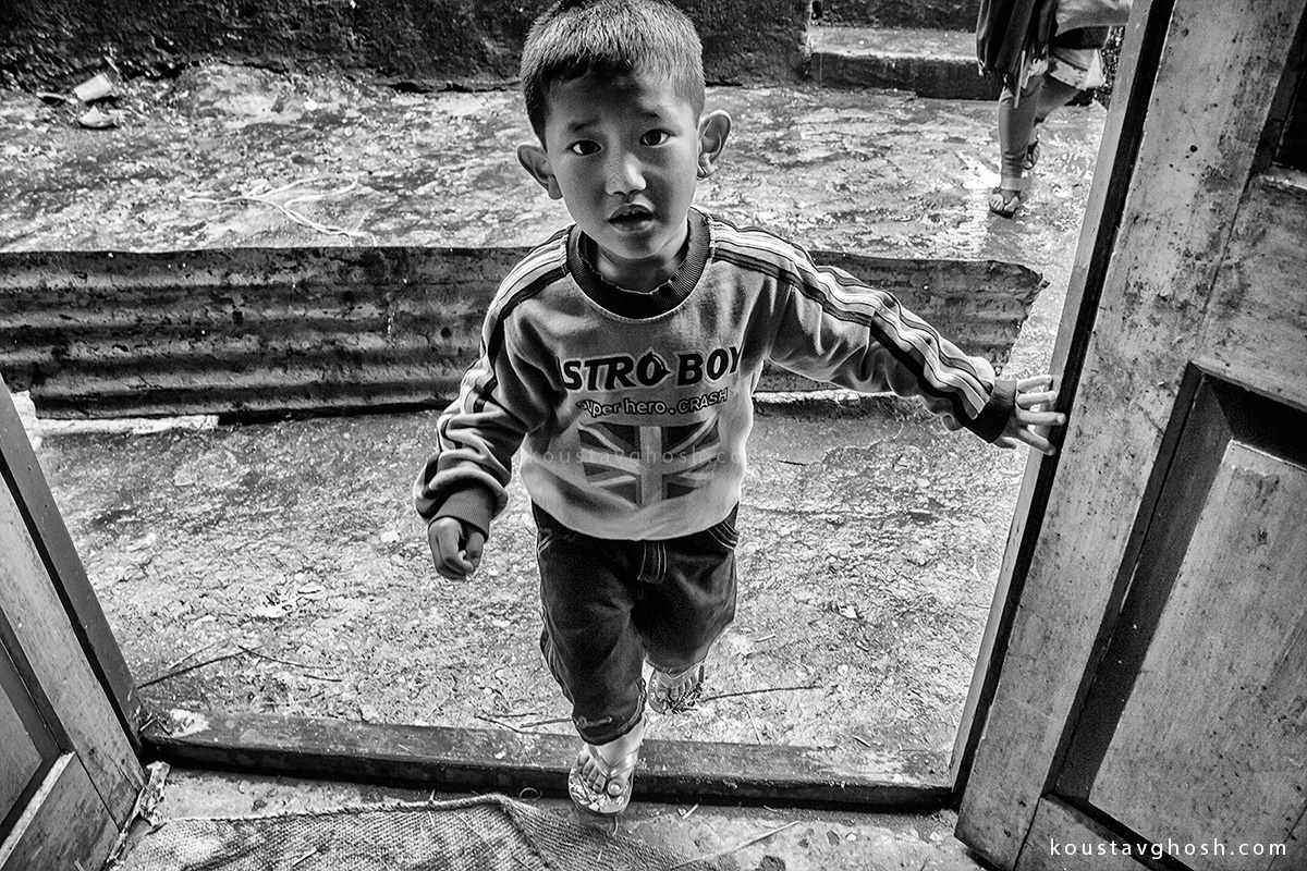 A little kid entering the Gurung Monastery